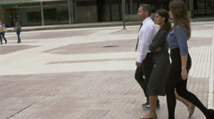 Business people walking on public plaza, slow motion shot at 240fps Stock Footage