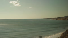 Traveling on train, looking out window viewing beach & waves-16 Stock Footage
