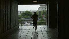 Businessman running through the passage, slow motion shot at 240fps Stock Footage