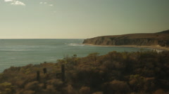 Traveling on train, looking out window viewing beach & waves-19 Stock Footage