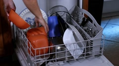 Closeup of woman emptying out dishwasher Stock Footage