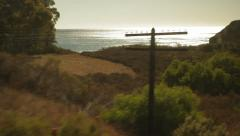 Traveling on train, looking out window land & ocean-22 Stock Footage