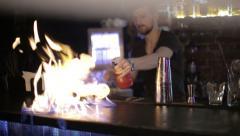 Bartender ignites bar Stock Footage