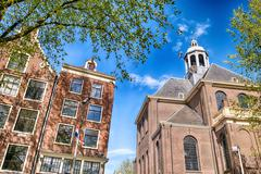 Wonderful architecture and vegetation of amsterdam in spring season Stock Photos