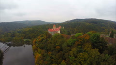 Old Czech castle 11 century Hrad Veveri, river red rooftops Stock Footage