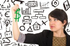 Young beautiful woman drawing money symbol with marker Stock Photos