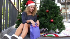 Happy Santa Girl with Christmas Gift, New Year Celebration with Fun and Joy. Stock Footage
