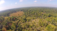 Flying over forest and prairie land Stock Footage