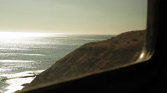 Traveling on a train, looking out window viewing hills & waves-07 Stock Footage