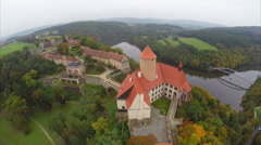 Red roofed castle in Czech Republic, land lords centuries aerial Stock Footage