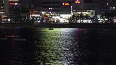 Nighttime Lights Reflect On Water At Gwangalli Beach Busan South Korea 4K Stock Footage