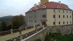 Old European castle land lords, river bridge aerial shot, Czech Stock Footage