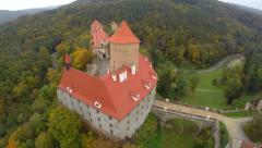 Fly around red rooftop ancient castle, aerial shot, bridge river Stock Footage