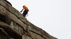 man trains to conquer the rock - stock footage