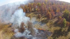Aerial view of a controlled fire, camera moving away. Stock Footage