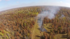 Smoke in the woods seen from the air Stock Footage