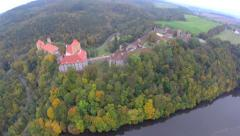 Aerial fly old medieval castle red rooftops, fortress defensive Stock Footage