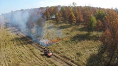 Flames moving towards the woods during a controlled fire Stock Footage