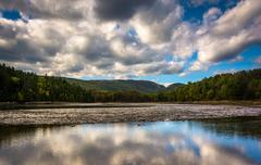 clouds and mountains reflecting in otter cove at acadia national park, maine. - stock photo