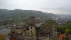 Flying around medieval castle, city dam, old fortress on river Stock Footage