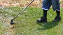 Weed Trimmer cuts grass, slow motion Stock Footage