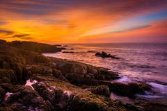 Sunrise over rocky coast and the atlantic ocean at acadia national park, main Stock Photos