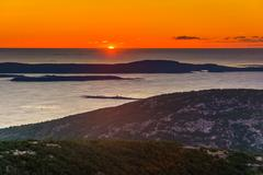 Stock Photo of sunrise view from caddilac mountain in acadia national park, maine.