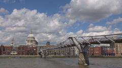 Millennium Bridge footbridge Thames River Saint Paul Cathedral London crowded UK Stock Footage