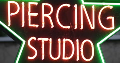 UHD 4K Sexy Pierced Tattoo Salon Body Piercing Studio Neon Sign Light Signage Stock Footage