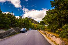 the park loop road in acadia national park, maine. - stock photo