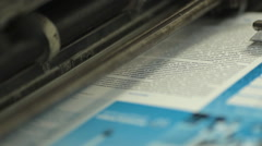 Close-up of colorful printing of leaflets at printing house Stock Footage