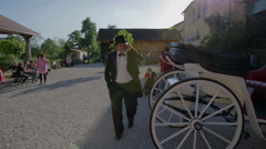 Coachman while taking on mobile phone - stock footage