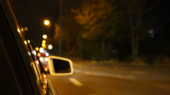 Looking out of the car window out of focus city lights night drive Stock Footage