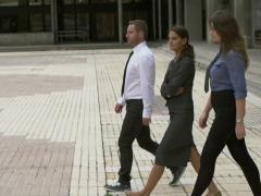 Business people walking on public square, slow motion shot at 240fps, steadycam Stock Footage