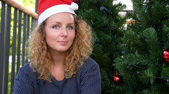 Happy Woman in Santa Hat Receives Christmas Present near X-mas Tree. Stock Footage