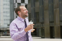 Happy businessman twisting and listening music, slow motion shot at 240fps Stock Footage
