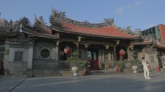 In Longshan Temple front courtyard Stock Footage