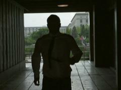 Businessman running through the passage, slow motion shot, steadycam shot Stock Footage