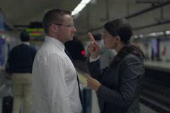 Businesspeople having quarrel on metro station, slow motion shot, steadycam shot Stock Footage