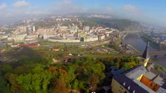 Small town establishing aerial shot, castle railroad buildings Stock Footage