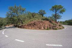 Worms eye view of mountain hairpin bend curved road Stock Photos