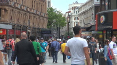Crowded pedestrian street Downtown London commercial road people shopping famous - stock footage