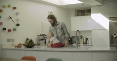 Father and daughter in kitchen Stock Footage