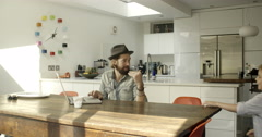 Father and son in kitchen Stock Footage