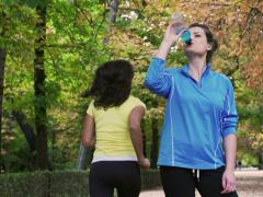 Sporty woman drinking energy drink, slow motion shot at 240fps, steadycam shot Stock Footage