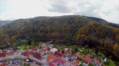 Autumn fall medieval castle aerial, colorful buildings bridge Stock Footage