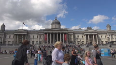 Tourist people visit National Gallery art museum Trafalgar Square London center  Stock Footage