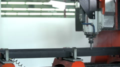 Special machine drills hole into metal Stock Footage