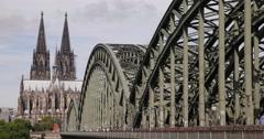 Ultra HD 4K Crowd People Walk Rush Hour Establishing Shot Bridge Cologne Skyline Stock Footage