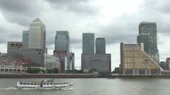 Canary Wharf financial district ship boat pass Thames river business skyscraper Stock Footage